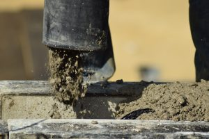 can you concrete over stage pipes